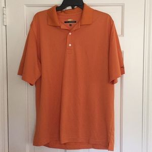 Greg Norman orange polo shirt